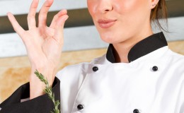 female chef with delicious hand sign